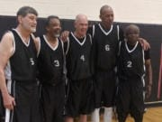 Battle Ground's Jim Nielsen, center, stands with his teammates during the National Senior Games last month in Albuquerque, N.M.