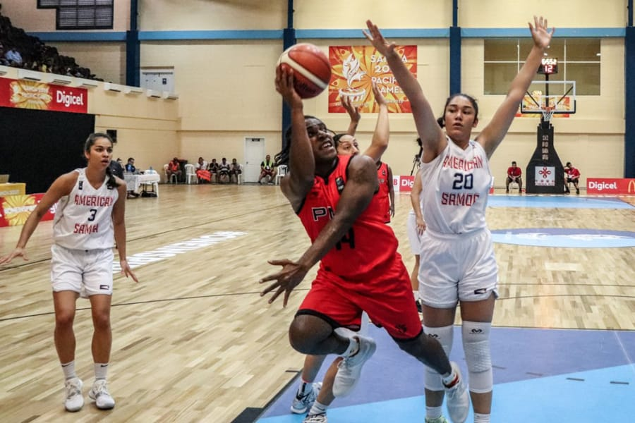 Katie Peneueta (20) defends a shot against Paupa New Guinea at the Pacific Games this month in American Samoa. Peneuata, a junior at Vancouver's Heritage High, helped American Samoa win the gold medal.