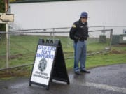 A Washington State Patrol officer mans a checkpoint at a Battle Ground School District school in October 2017, looking for drivers with out-of-state license plates.