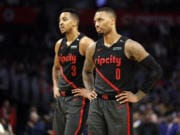 CJ McCollum (3) signed a three-year extension Tuesday that will keep him teamed up in the Blazers' backcourt for five more season with Damian Lillard (0).