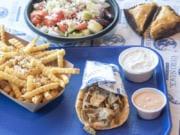 Greek fries, from left, Greek salad, Gyreuben, and a slice of baklava at The Gyro Shack.
