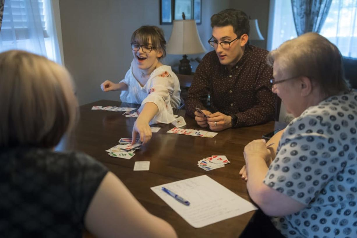 Kylie Sickles and Jorge Vicente react as Sickles plays her last card in a game of Phase 10 at the Sickles' home in Salmon Creek in June. Vicente spent his junior year at Skyview High School as an exchange student.