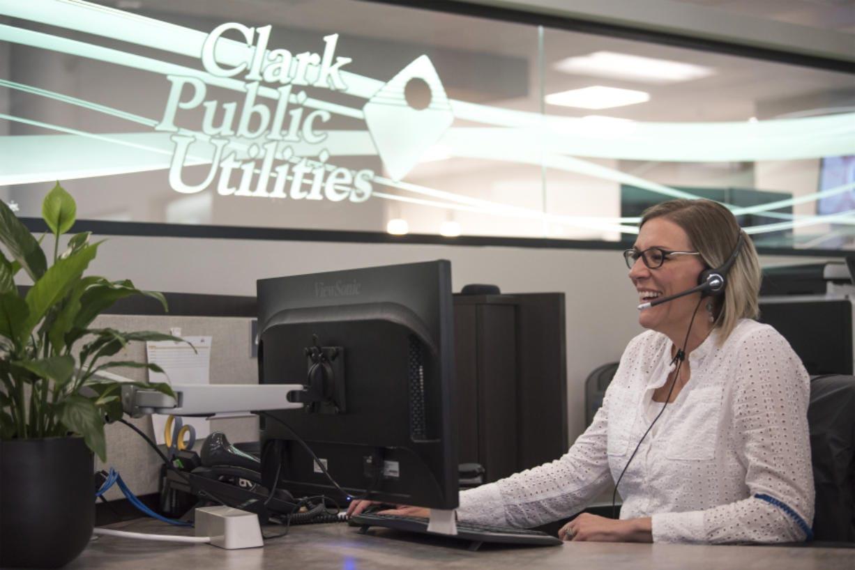 Customer service representative Kristina Beagle helps a customer over the phone at Clark Public Utilities.