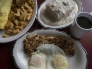 A jalapeno-and-mushroom omelette with toast and fried potatoes, clockwise from left, biscuits and gravy and the two-egg breakfast with hash browns at Christine's.
