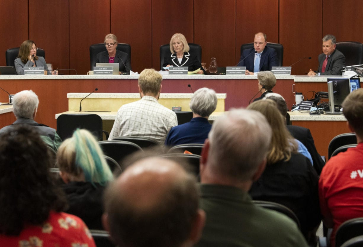 The Clark County council votes 3-2 to lift the ban of recreational marijuana businesses in unincorporated Clark County during its meeting in Vancouver on Tuesday. The change takes effect Jan. 1, 2010.