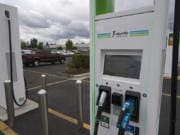 A motorist passes by an electric vehicle charging station at the Walmart store in Hazel Dell. Electrify America and Walmart have installed electric vehicle charging stations at Walmart stores across Washington, including this one in Vancouver. This effort is part of a broader plan to develop a coast-to-coast EV charging network, which would make Walmart one of the largest retail hosts of EV charging stations across the United States.