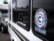 C-Tran pastes new stickers to celebrate their recent award on their buses during a special event at the C-Tran offices in Vancouver on July 9, 2019. C-Tran revealed that The American Public Transportation Association has selected the company as its Transit System of the Year for 2019.