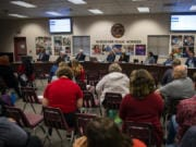 Vancouver Public Schools board members listens to public comment during a Tuesday meeting.