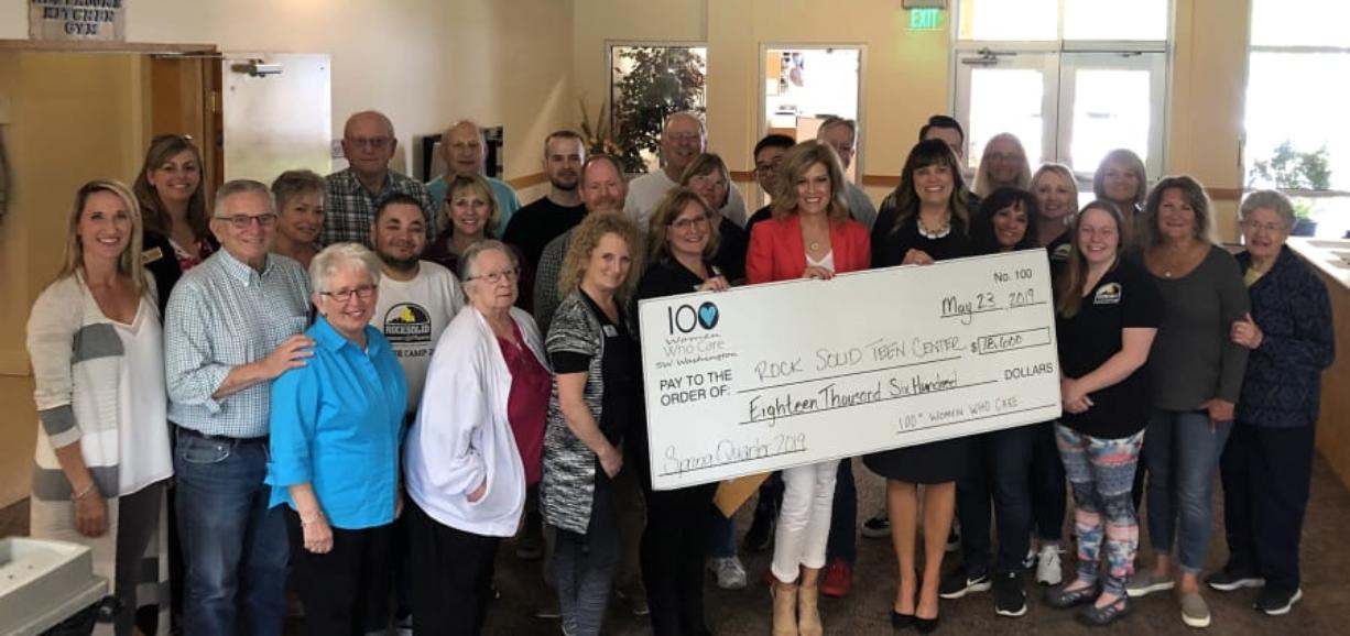Brush Prairie: Representatives from 100 Women Who Care recently brought a check for $18,600 to the Rocksolid Community Teen Center.
