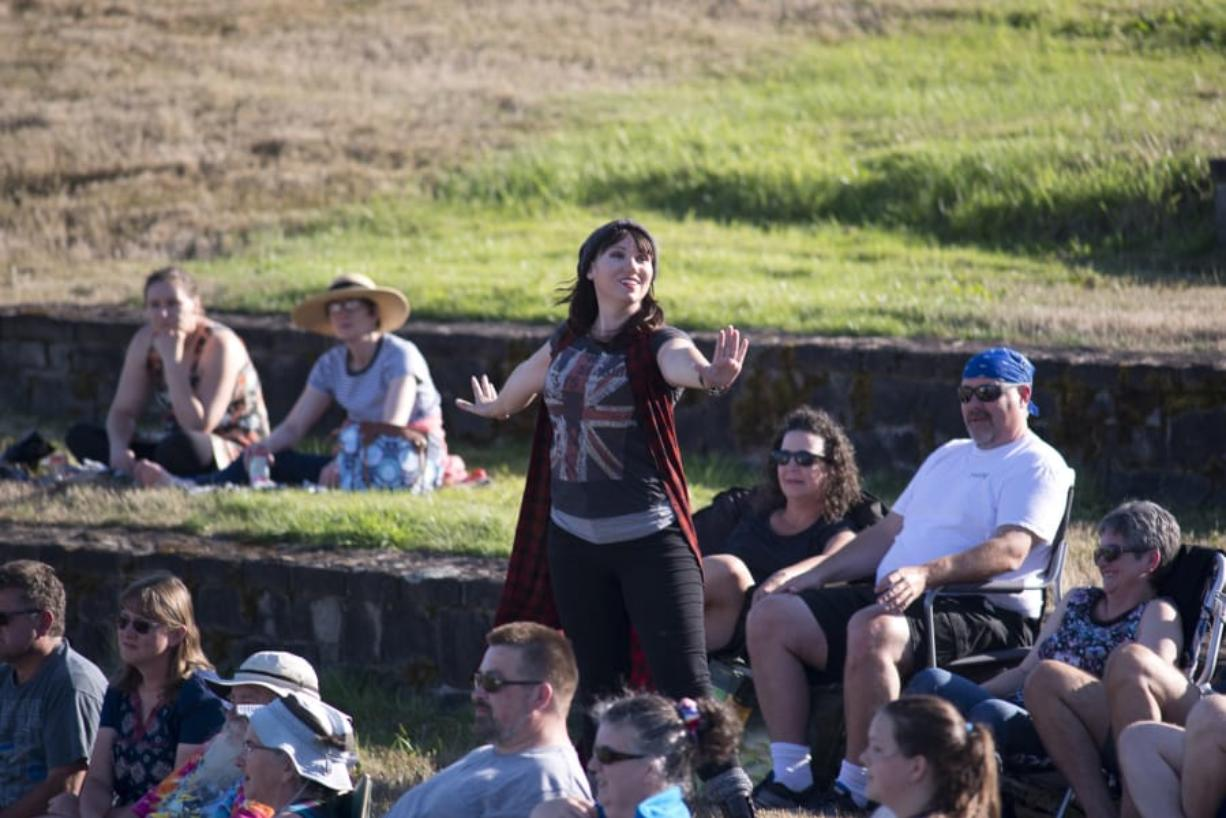 """Laura Hankins as the pompous Petrucio explains the method behind her madess in William Shakespeare's comedy """"The Taming of The Shrew,"""" at Washington State University Vancouver's campus amphitheater. Metropolitan Performing Arts is presenting the play at several different outdoor Clark County locations this summer."""