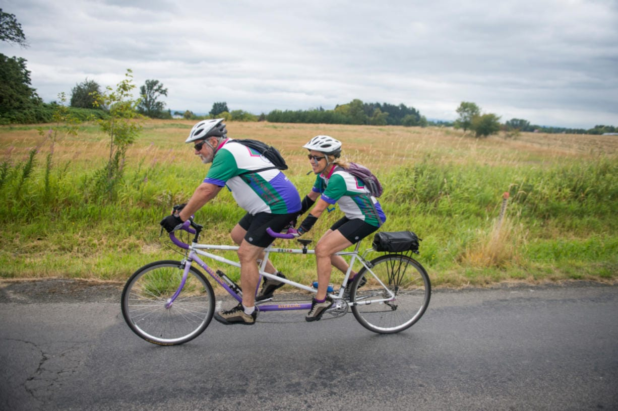 Paul and Liz Grun ride a tandem bicycle during Saturday's Ride Around Clark County. The Vancouver Bicycle Club's annual event allowed riders to select from five routes ranging from 20 to 100 miles.