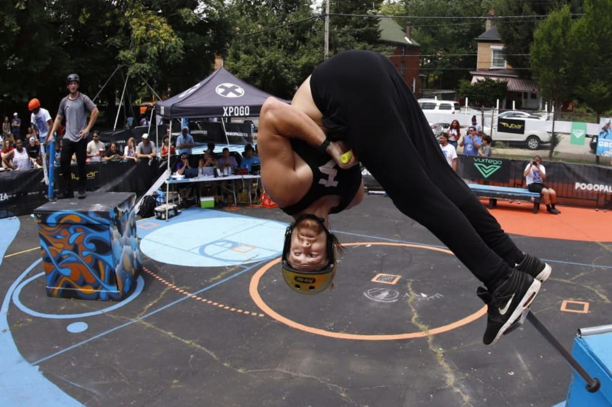 Harry White, of Orillia, Canada, performs in Pogopalooza, The World Championships of Pogo in Wilkinsburg, Pa., Saturday, July 20, 2019. White is the only Canadian in the two day competition. (AP Photo/Gene J.