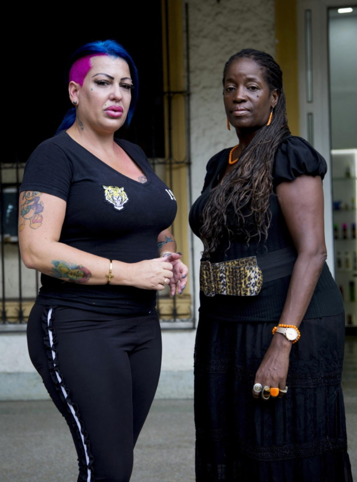In this June 28, 2019, photo, Dianelys Alfonso, left, singer stands with her lawyer Deyni Terry, for a photo during an interview with The Associated Press in Havana, Cuba. Alfonso publicly denounced another renowned musician, flutist and bandleader José Luis Cortés, accusing him of repeatedly hitting and raping her during her time as vocalist for NG La Banda. Terry said she and her client are investigating whether they can bring charges of abuse and sexual assault against Cortés many years after the alleged crimes took place. (AP Photo/Ismael Francisco)