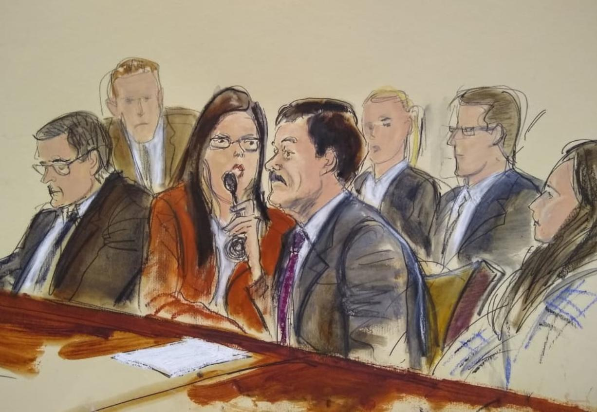 "In this courtroom sketch, Joaquin ""El Chapo"" Guzman, right, listens to his sentence via interpreter Wednesday in New York. At left is defense attorney Marc Fernich."