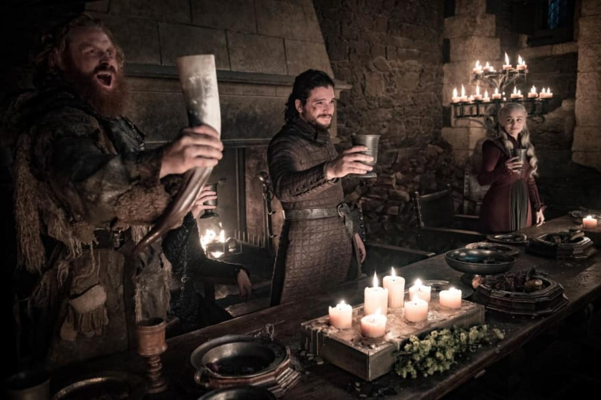 """This image released by HBO shows Kristofer Hivju, from left, Kit Harington and Emilia Clarke in a scene from """"Game of Thrones."""" """"Game of Thrones,"""" """"Veep"""" and """"The Big Bang Theory,"""" three major series that wrapped last season, will find out with Tuesday's nominations if they have one more chance at Emmy gold."""