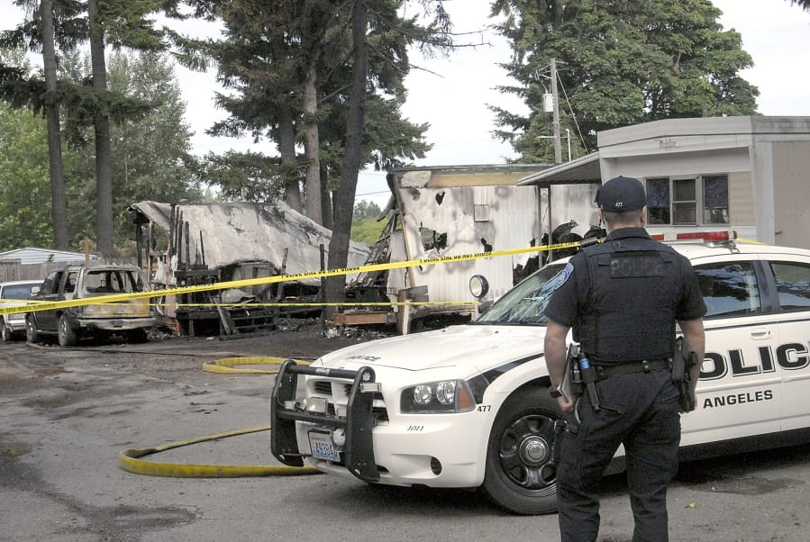 Man arrested in Washington mobile home fire that killed 4