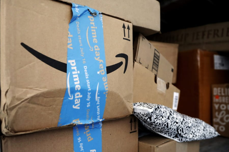 37a391290193cd FILE - In this July 17, 2018, file photo Amazon Prime packages sit in