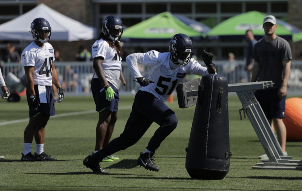 Seattle Seahawks Barkevious Mingo (51) was a first-round draft pick out of LSU, where he starred at defensive end. After playing linebacker last season, Mingo has moved back to that position to help fill the void after Frank Clark's was traded to Kansas City.
