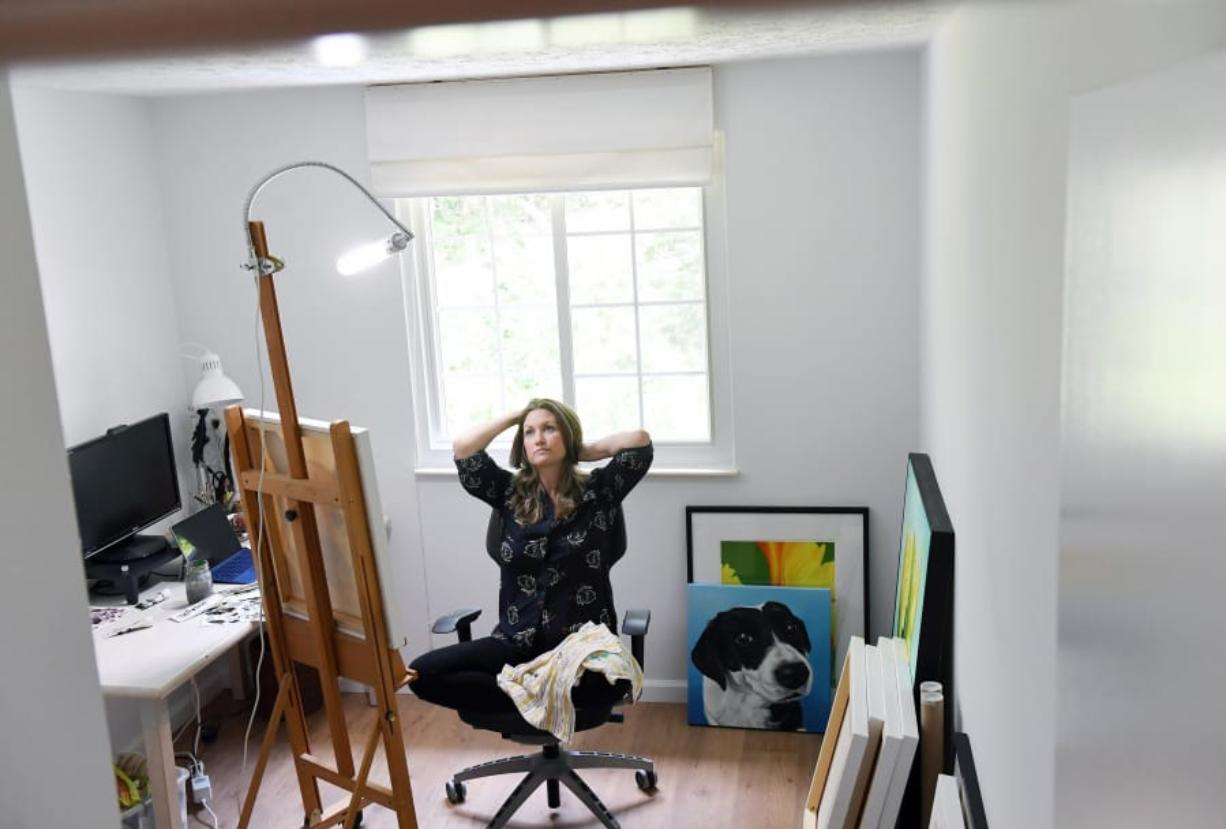Erica Eriksdotter pauses for a moment while working in her home studio July 28 in Reston, Va.