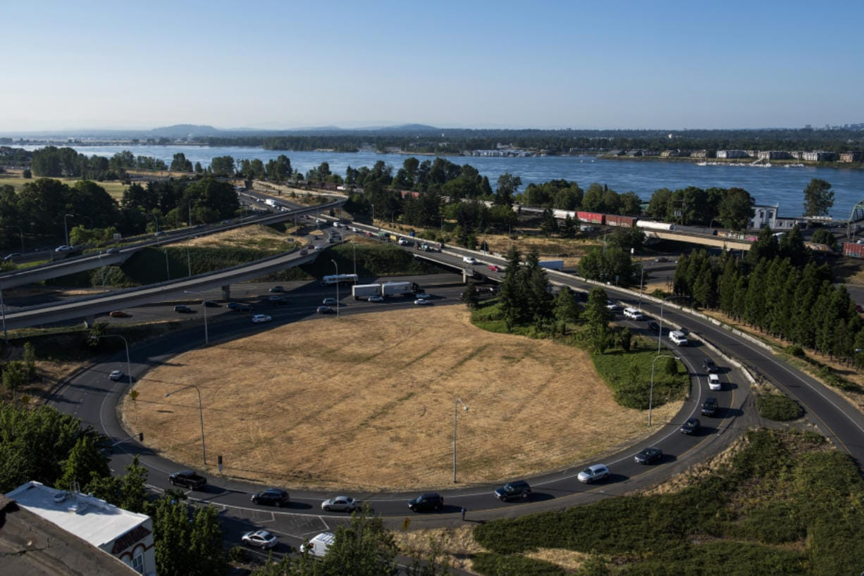 Traffic moves around the partial cloverleaf interchange from state Highway 14 onto southbound Interstate just north of the Interstate Bridge in Vancouver.