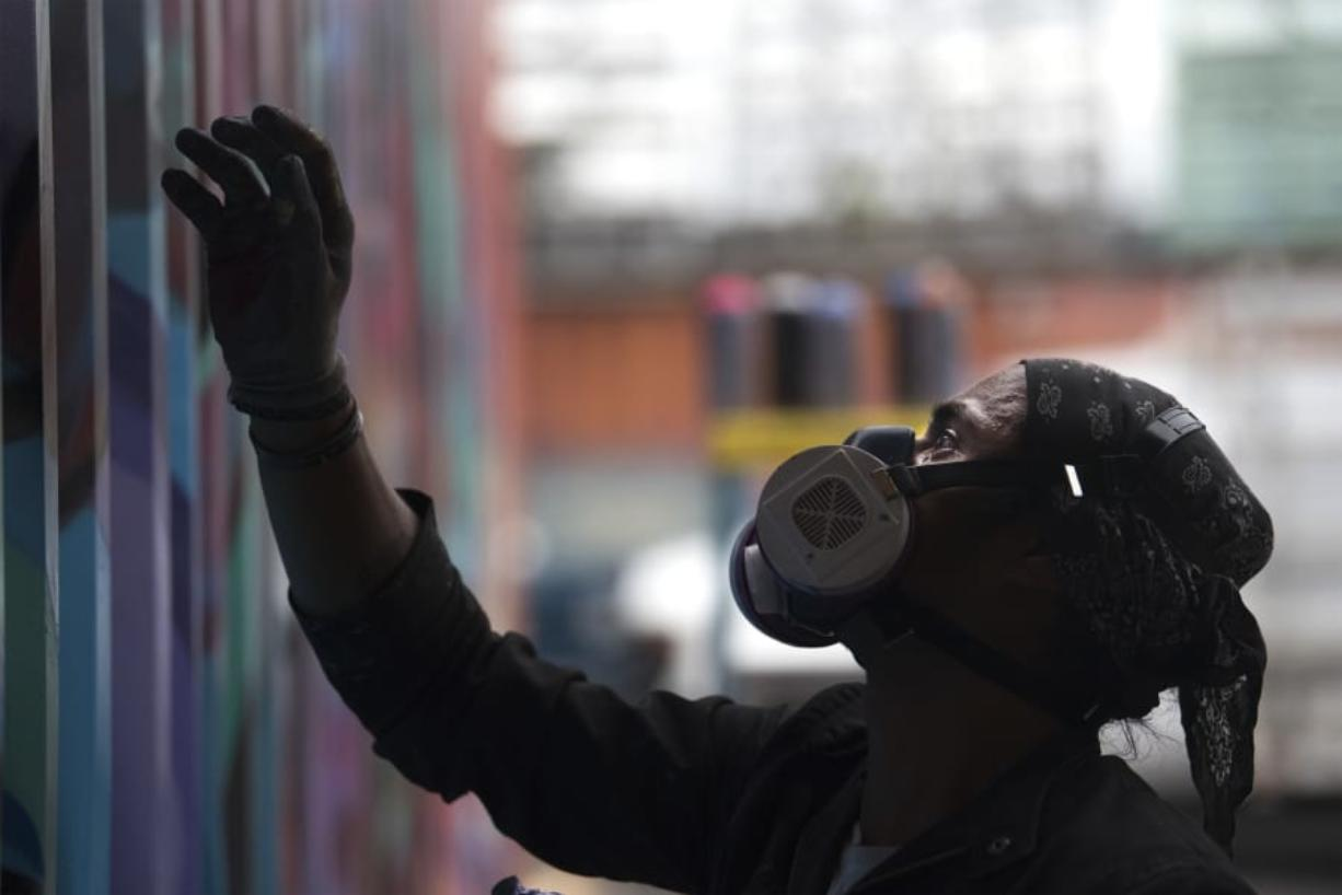 """Artist Raphe Hec said creating murals with spray paints is like dancing. """"I want to feel the energy in the colors,"""" he said."""