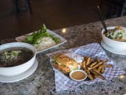 The Pho Tai Nam (eye round and flank noodle soup), from left, the Krispy Chicken Burger and the Vegetarian Noodle Soup at the Kooky Chicken.