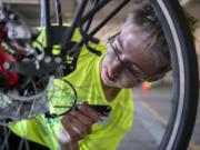 Bike Skills 101 Camp counselor Aidan Billingsley, 16, teaches participants how to repair bike brakes. He rides his bike to get to school and his summer job.
