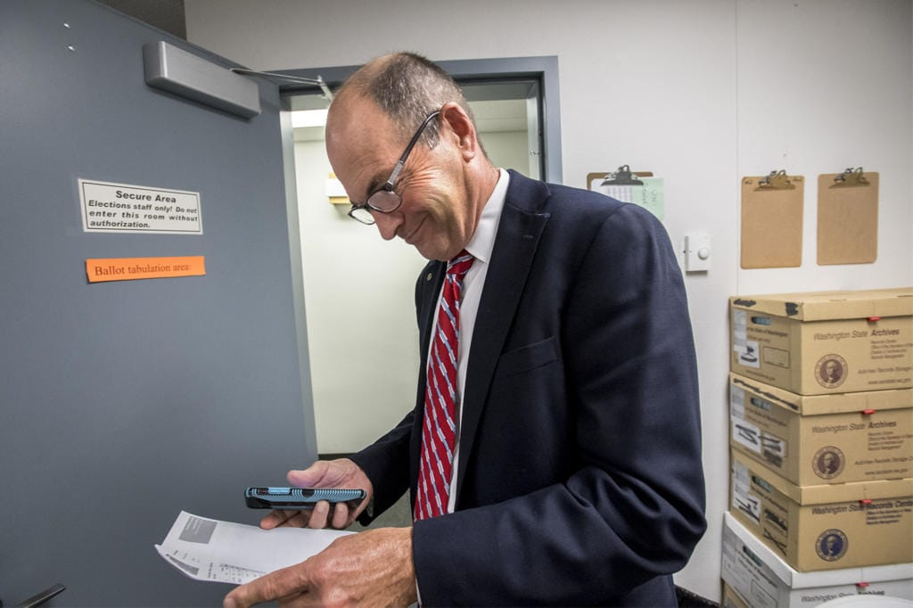 Clark County Auditor Greg Kimsey views the first primary election result printout in the Ballot Tabulation Room of the Clark County Election Office on Tuesday night, Aug. 6, 2019.