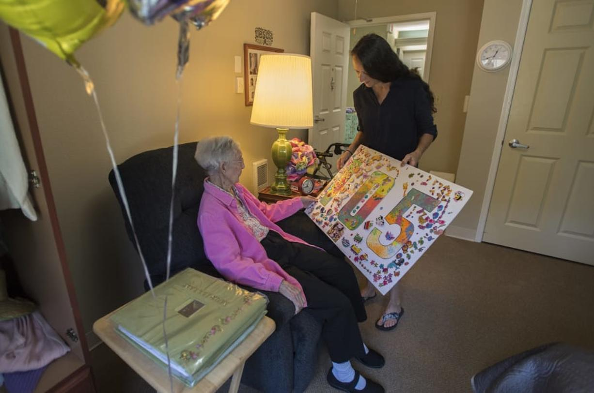 """Murillian """"Mimi"""" Allen of Vancouver celebrates her 105th birthday with her granddaughter-in-law, Tammie Gower of Washougal, at Brookdale Vancouver Stonebridge on Monday afternoon."""
