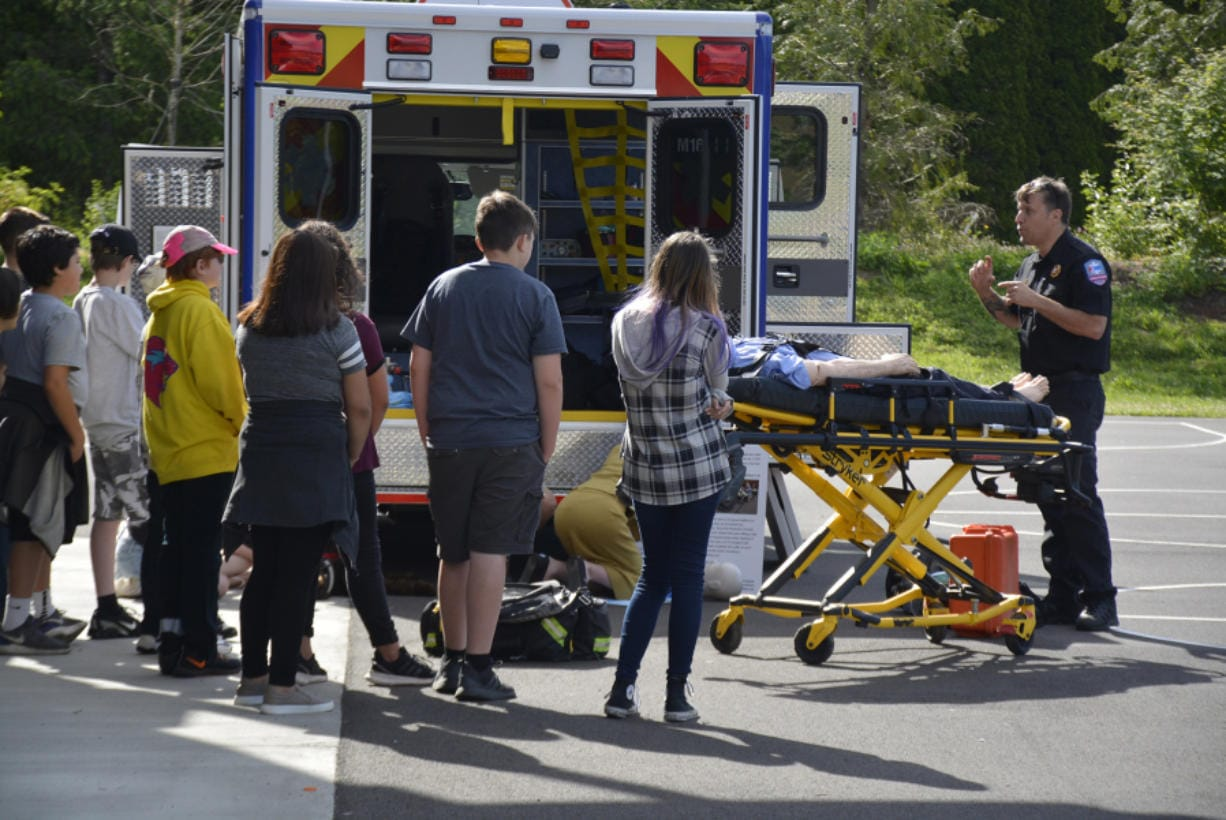 WASHOUGAL: Jemtegaard Middle School students learn from paramedic Andrew Cherry at their annual career fair.