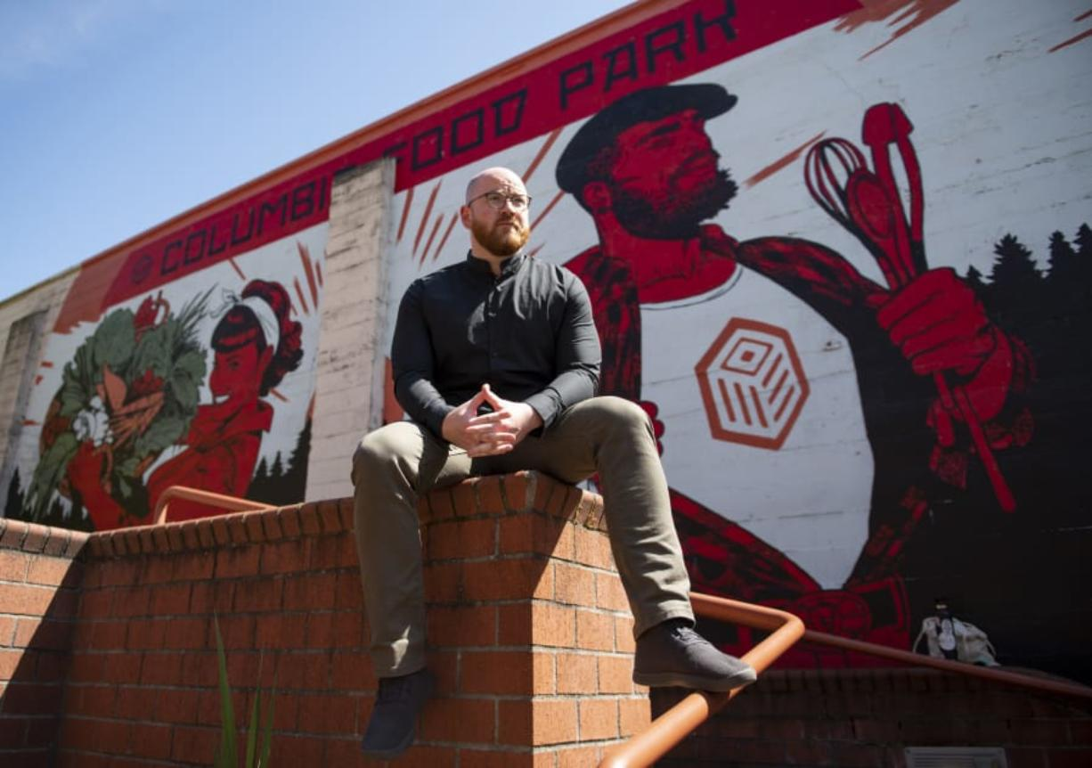 Founder Alex Mickle sits in front of a mural at the Columbia Food Park, which recently celebrated the completion of its commercial kitchen. Photos by Zach Wilkinson/The Columbian