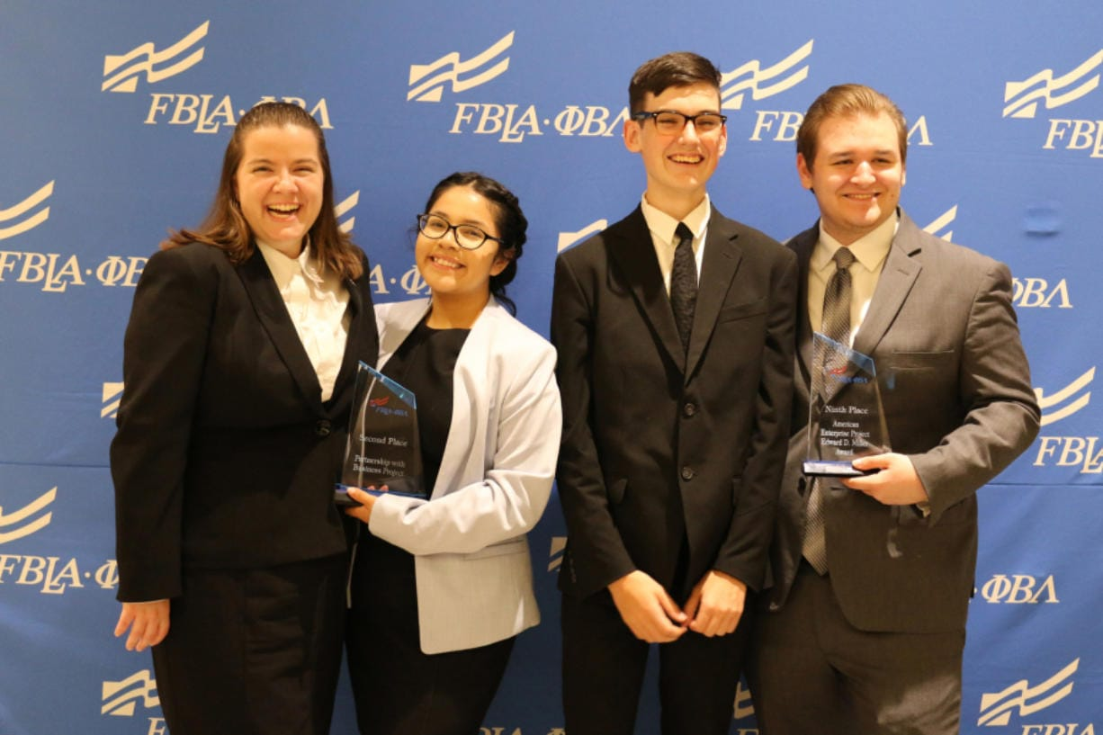 ORCHARDS: Two teams from Heritage High School's Future Business Leaders of America received awards at the FBLA National Leadership Conference, held July 2 in San Antonio. Victoria Thornton and Elvia Santos-Dominguez placed second in a Partnership with Business Project, while Matthew Lipinski and Daniel Adams took ninth place with their American Enterprise Project.