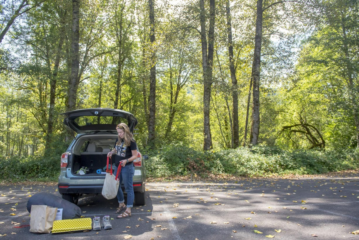 Sarah Croston, assistant guide and educator at the Mount St. Helens Institute takes stock of her equipment while preparing to lead a hike to the Mount. St. Helens crater. (Nathan Howard/The Columbian)