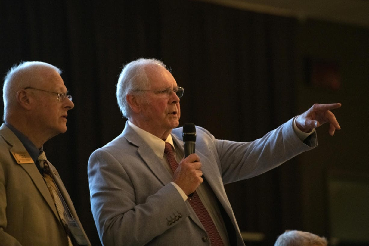 Clark County Republican Party Chair Earl Bowerman, right, acknowledges a speaker during a local Republican Party meeting in August at the Bethesda Church in Vancouver.