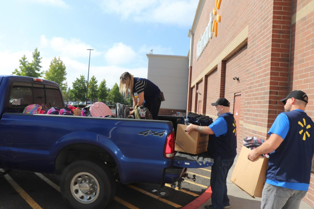 BENNINGTON: Volunteers load backpacks full of school supplies at the 430 S.E. 192nd Ave. Walmart Supercenter. Two-hundred kits were put together for approximately 100 military families in Clark County with a parent deployed or scheduled for deployment.