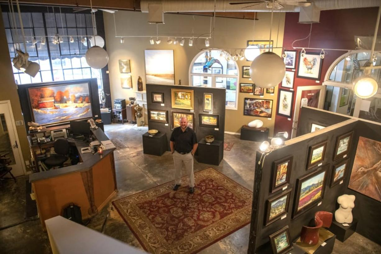 "Kevin Weaver is surrounded by artwork at his gallery, Art On The Boulevard. ""I always joke with people that I have the best office in town,"" said Weaver, who was recently named to the city's revived Arts, Culture and Heritage Commission. Zach Wilkinson/The Columbian"