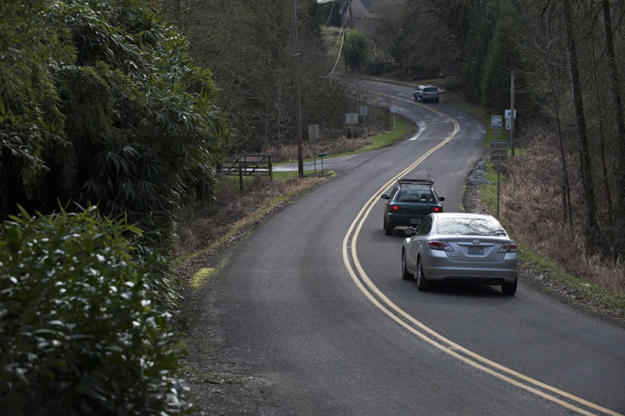 Drivers prepare to enter Ridgefield along the curvy, two-lane portion of Main Avenue, as seen in February 2016. Work started recently to add a dedicated pedestrian walkway and bike path along the road to make it easier to get to the Ridgefield National Wildlife Refuge. Amanda Cowan/The Columbian