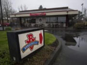 A sign directs customers to the Burgerville restaurant on Southeast Mill Plain Boulevard.