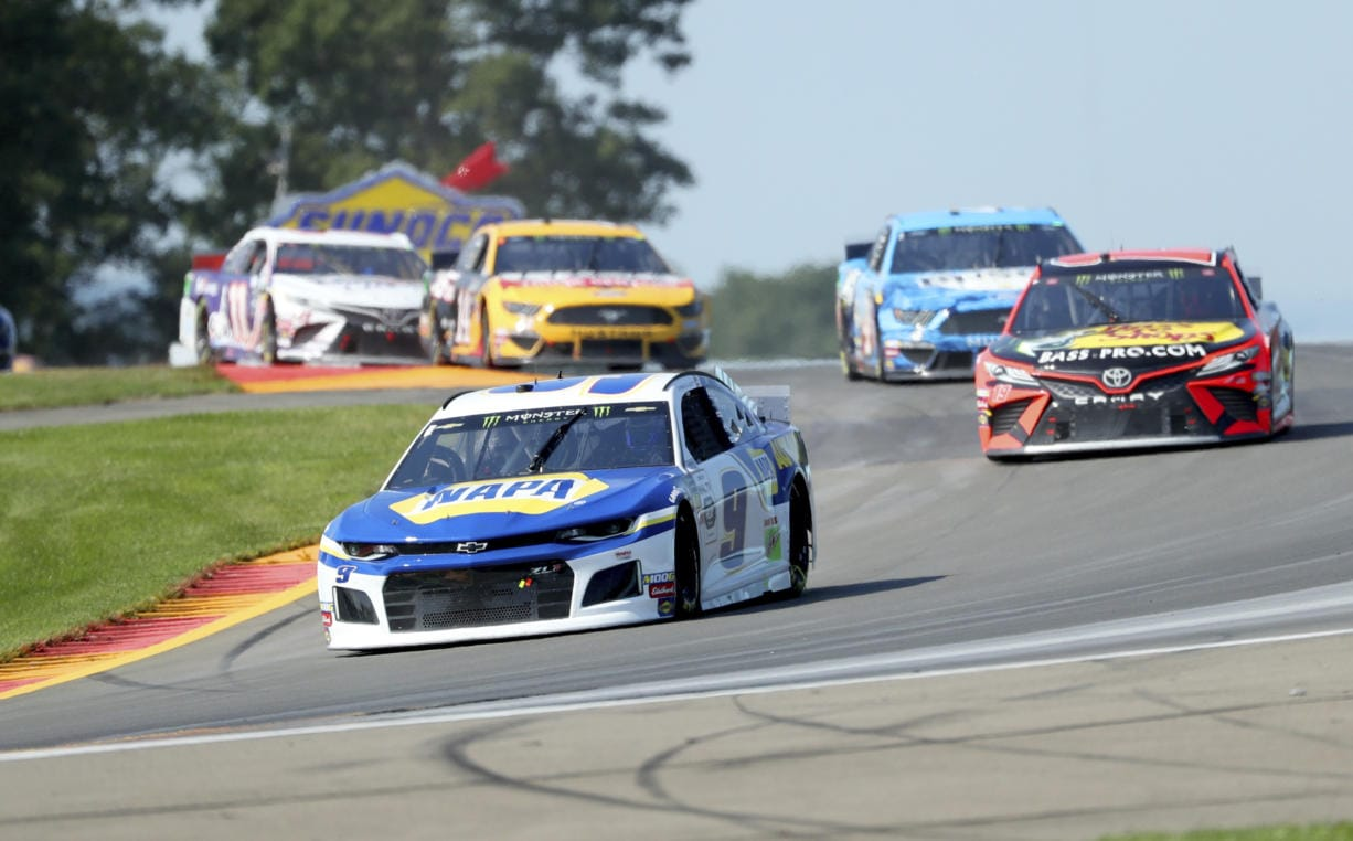 """Chase Elliott leads the field thought the area known as """"The Bus Stop"""" during a NASCAR Cup Series auto race at Watkins Glen International, Sunday, Aug. 4, 2019, in Watkins Glen, N.Y."""