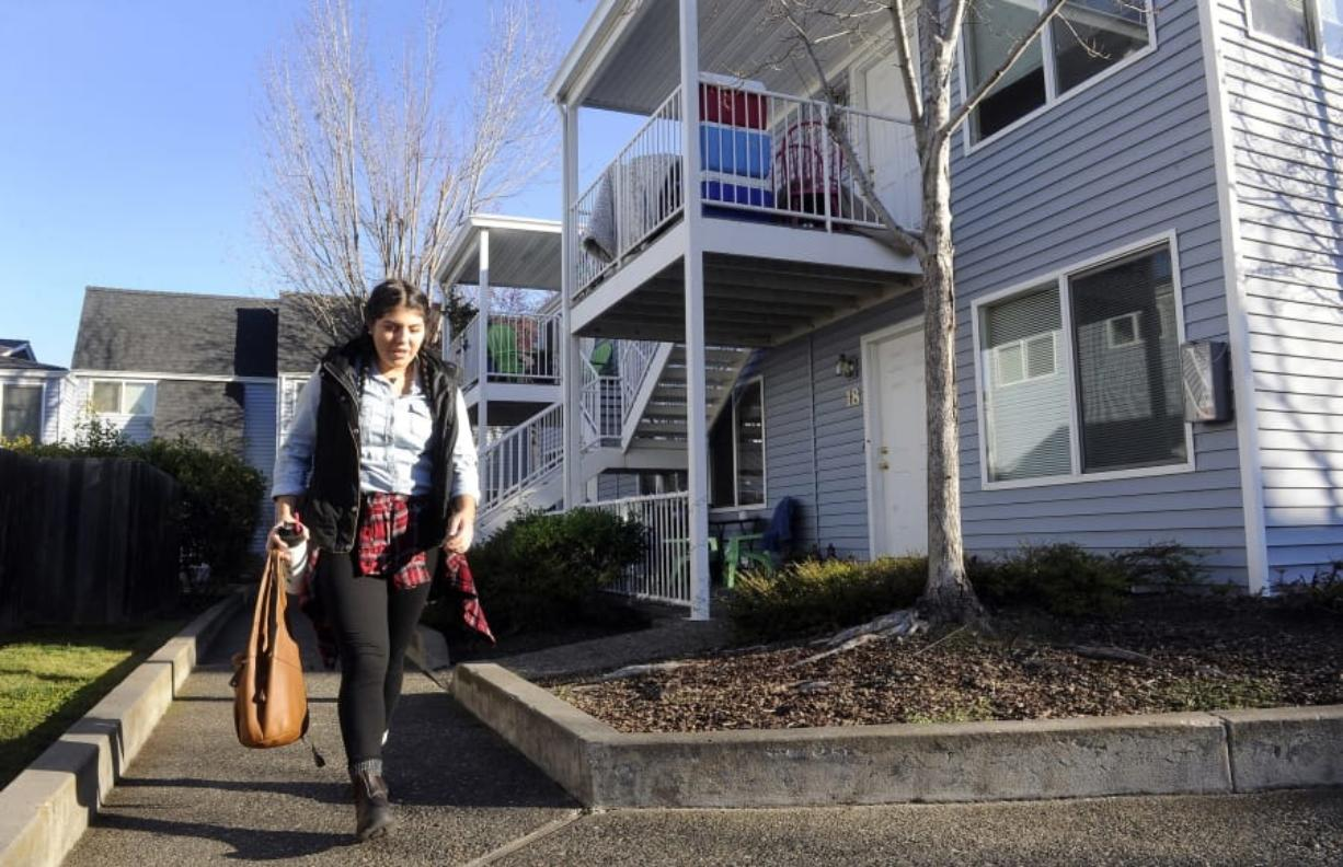 Monica Magdaleno leaves her apartment Dec. 7, 2017, on Garfield Street in Ashland, Ore. Gov. Kate Brown signed a first-in-the-nation law Thursday to encourage the development of duplexes, triplexes and other more affordable types of housing. Andy Atkinson/The Medford Mail Tribune
