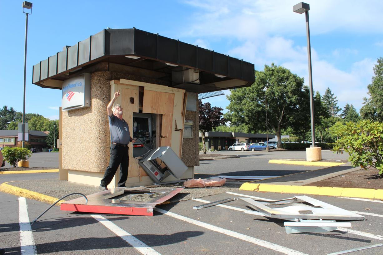 Vancouver police say someone used a stolen construction vehicle to break open this ATM at 5411 E. Mill Plain Boulevard early Friday morning.