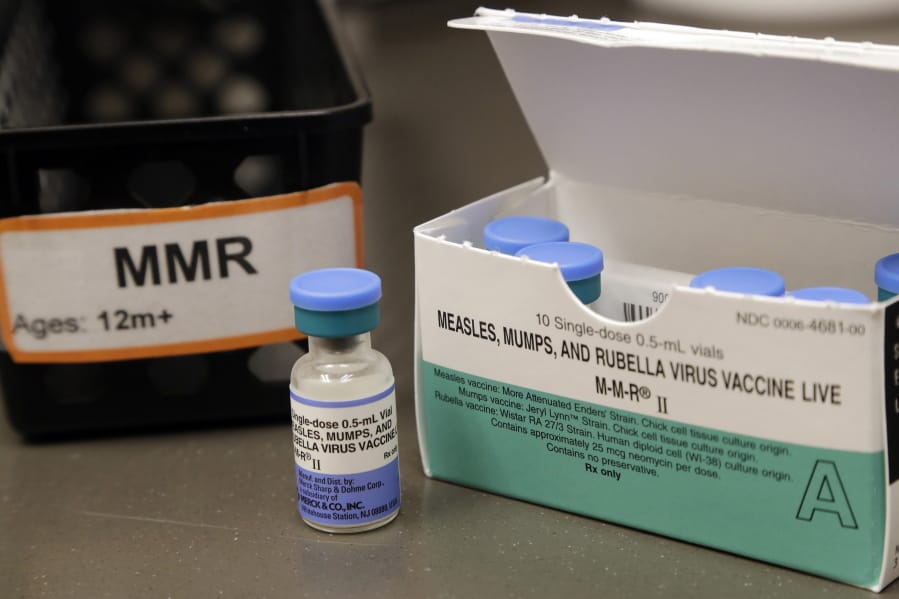 FILE - This May 15, 2019 file photo shows a vial of a measles, mumps and rubella vaccine at a clinic in Vashon Island, Wash.