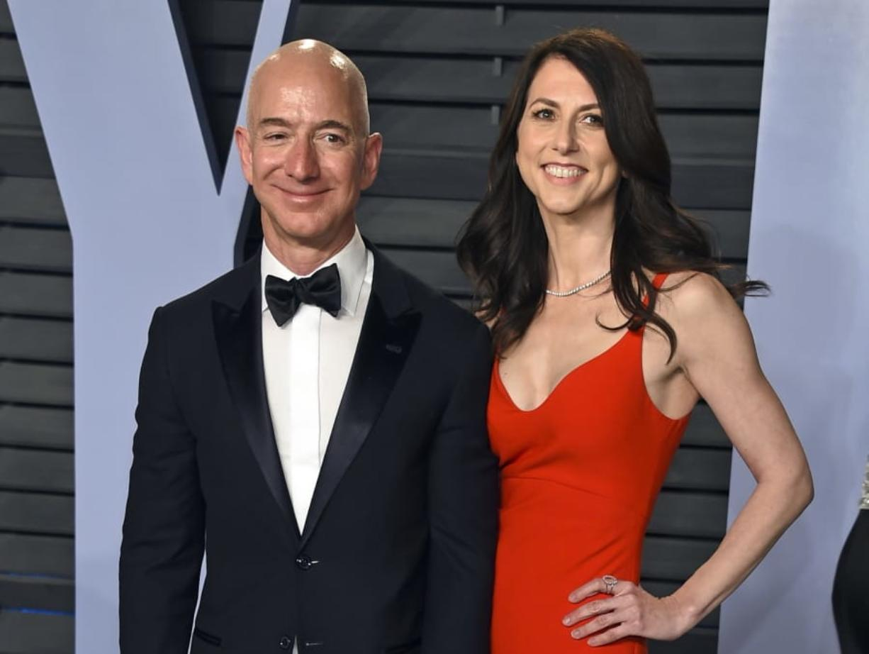 FILE - In this March 4, 2018 file photo, Jeff Bezos and wife MacKenzie Bezos arrive at the Vanity Fair Oscar Party in Beverly Hills, Calif. Amazon founder Jeff Bezos and his ex-wife, MacKenzie Bezos, have divided up their stake in Amazon. In a government filing late Wednesday, July 31, 2019, Amazon disclosed that Jeff Bezos now has an 11.8% in the company worth nearly $110 billion after completing the divorce and cashing in some $2 billion worth of stock. (Photo by Evan Agostini/Invision/AP, File)