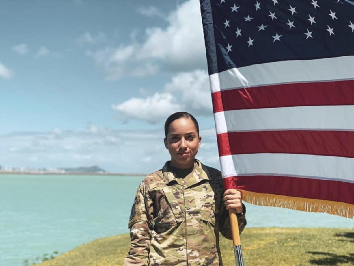 In this June 2019, photo, U.S. Air Force Senior Airman Xiara Mercado stands at Pearl Harbor, Hawaii. A Facebook post by Mercado, of Puerto Rico, drew wide attention when she described a recent encounter at a Honolulu Starbucks with a woman who complained about her talking in Spanish on the phone. Mercado wouldn't comment on recent anti-Latino violence that has terrified many Hispanics, but insisted people should speak up when they suffer discrimination. (Xiara Mercado via AP)