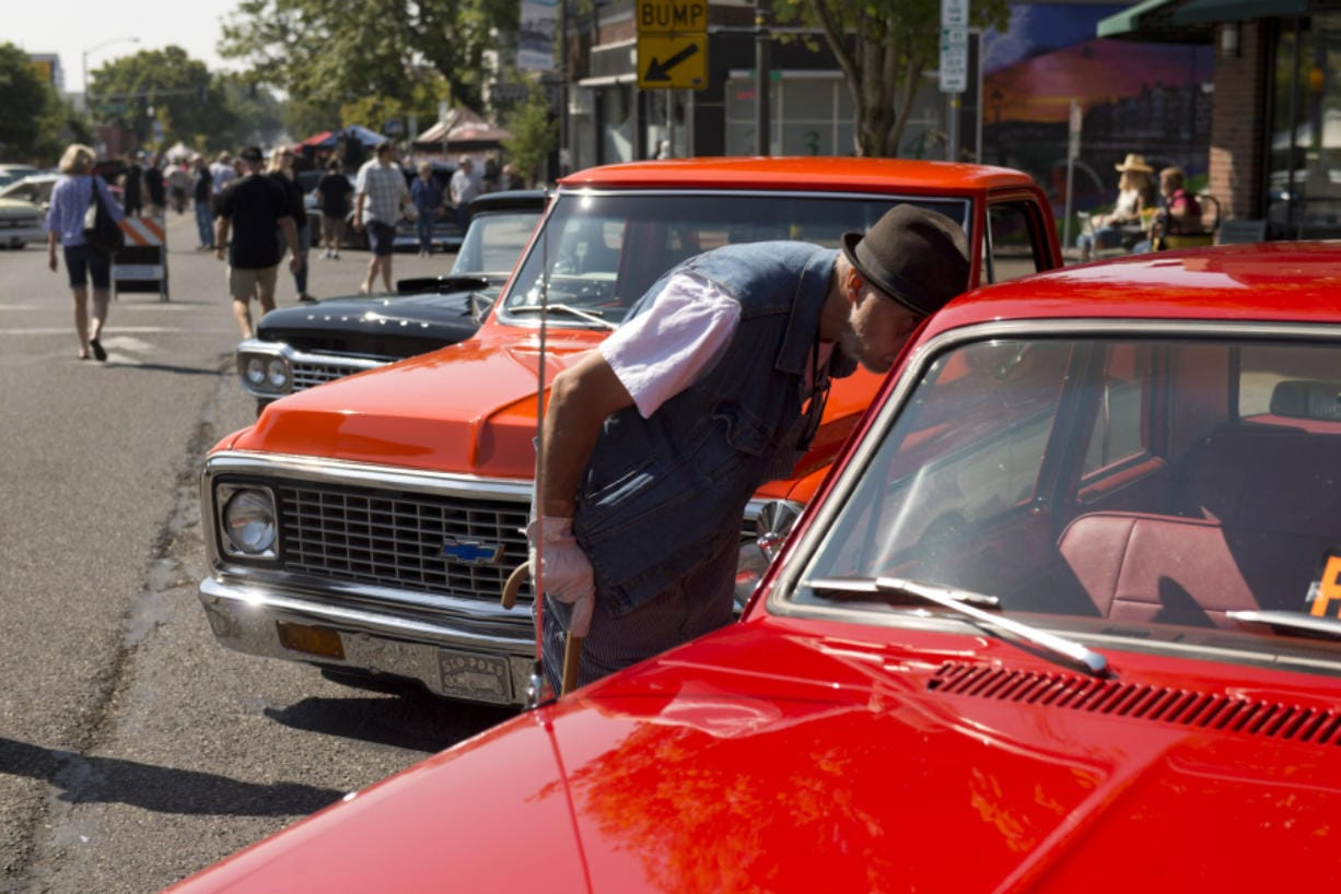 The annual Slo Poks Show & Shine Car Show in Uptown Village Aug. 17 is a revved-up fundraiser for The Hough Foundation. James Rexroad/The Columbian files