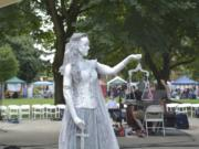 Jaime Brooks portrayed a living statue of Lady Justice at last year's Peace and Justice Fair.