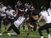 Washougal's Peter Boylan (18) breaks through the Woodland defense. The Panthers are talented on both offense and defense, having allowed 23 points per game last season.