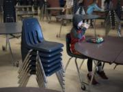 Fifth-grade student Daniel Casanova finishes his lunch in the mostly empty cafeteria of Chinook Elementary School in March after his fellow students left for recess. A state audit released last week found that elementary schools overwhelmingly are not providing children with enough time to eat their meals.