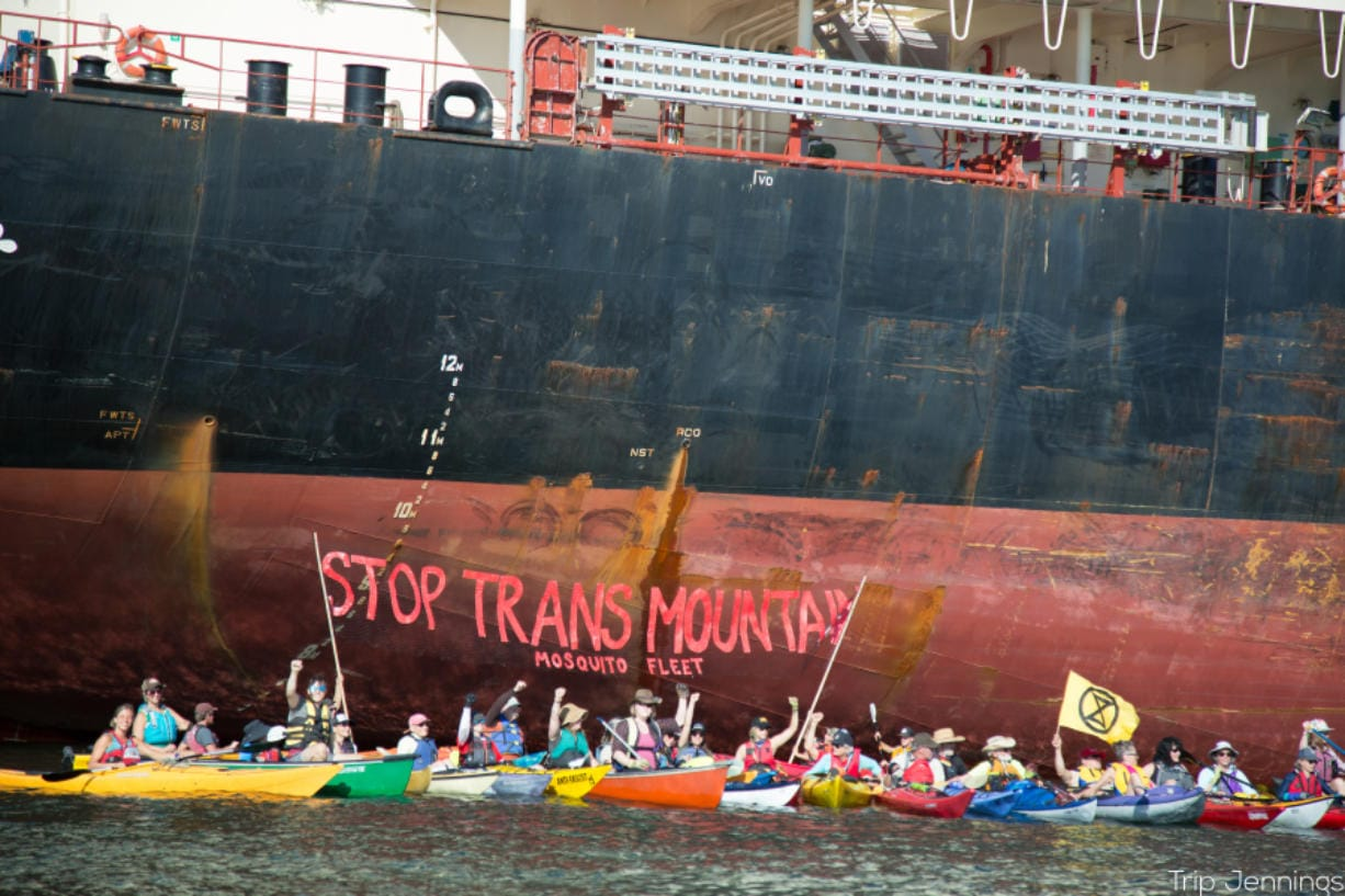 Protesters from the Mosquito Fleet paddled out from Kelley Point Park in Portland on Monday to the Port of Vancouver to protest a cargo ship they say is carrying pipe to be used for an expansion of the Trans Mountain Pipeline. Photos courtesy of Mosquito Fleet