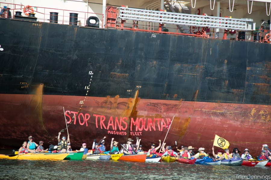 Protesters from the Mosquito Fleet paddled out from Kelley Point Park in Portland on Monday to the Port of Vancouver to protest a cargo ship they say is carrying pipe to be used for an expansion of the Trans Mountain Pipeline.
